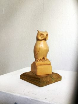 Woodcarving of smal owl